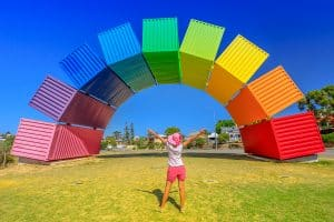 Happy Woman With Open Arms Looking Rainbow Sea Container In Frem